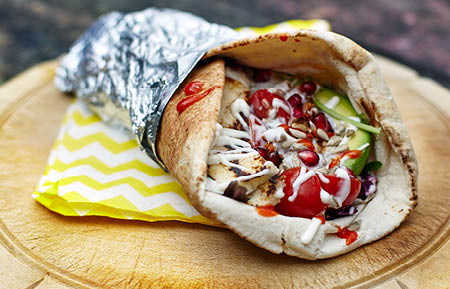 Camden Market food - Chia halloumi wrap with tomatoes, avocado, pomegranate and  sunflower seeds